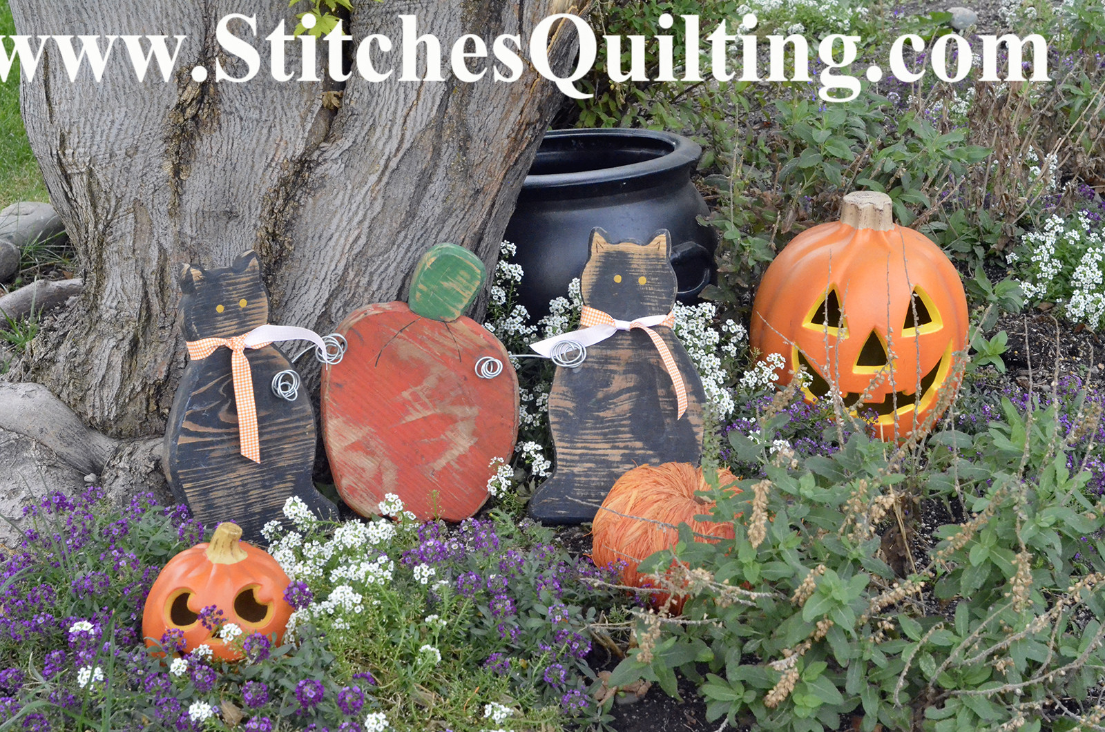 How about just decorating your lovely gardens with some Halloween embellishments! It doesn't take much! These are some old pieces of wood cut and simply painted.
