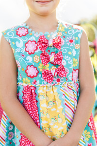 Need to remember the custom embellishments on this darling dress with bow ties and striped cording cut on the bias!