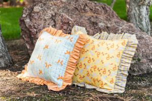 Ruffled Pillows of woodland forest wild life friendly animals of deer, fox, squirrel, birds, trees in colors of orange, tans, green and grays. Good Natured fabric collection with Riley Blake Fabrics.