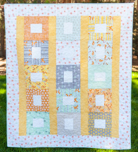 Baby Quilt of woodland forest wild life friendly animals of deer, fox, squirrel, birds, trees in colors of orange, tans, green and grays. Good Natured fabric collection with Riley Blake Fabrics.