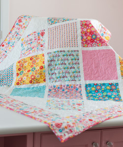Check out this simple quilt in amazing Girl Crazy Fabrics by Designs by Dani for Riley Blake! The fabric makes the quilt pop!