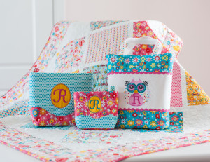 Check out these simple quilt in amazing Girl Crazy Fabrics by Designs by Dani for Riley Blake! The fabric makes the quilt pop! Notice those simple ric rac embellished and embroidered tote bags with Sew Michelle Patterns