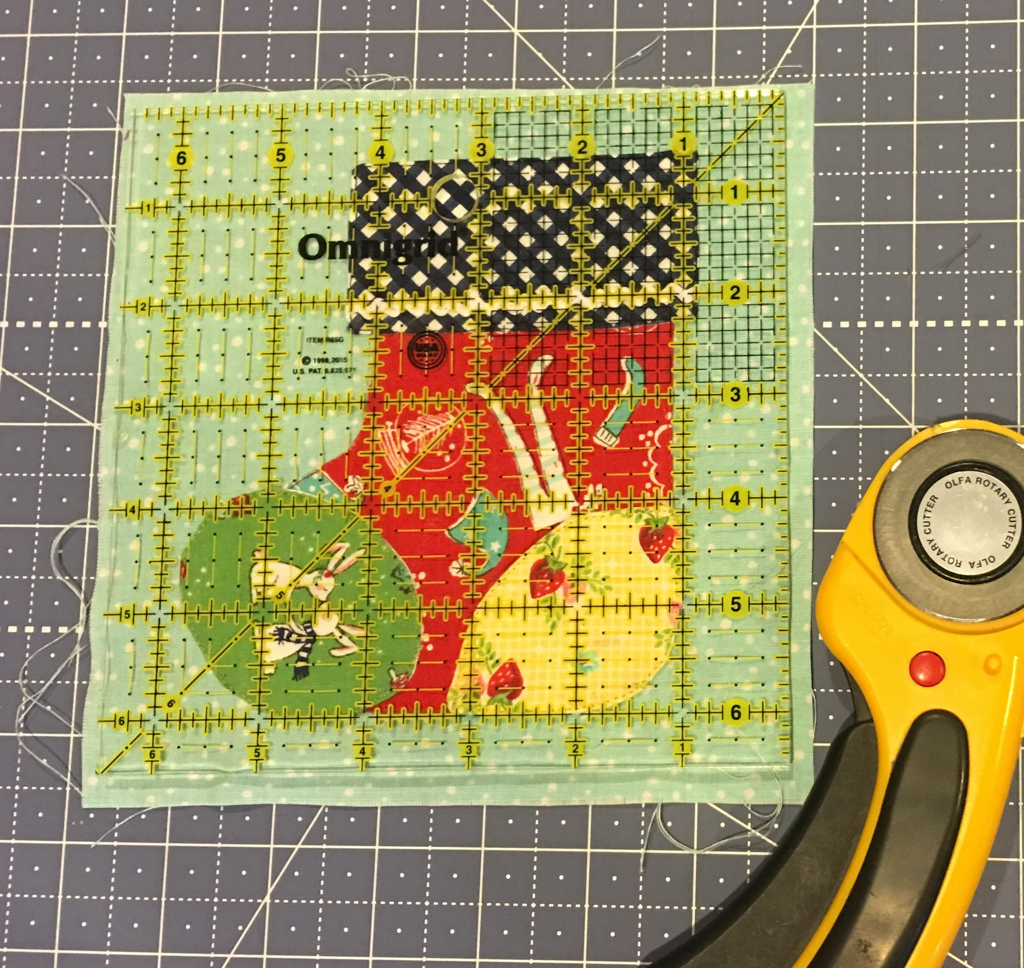 Trimming the appliqué block with an Omnigrid square ruler