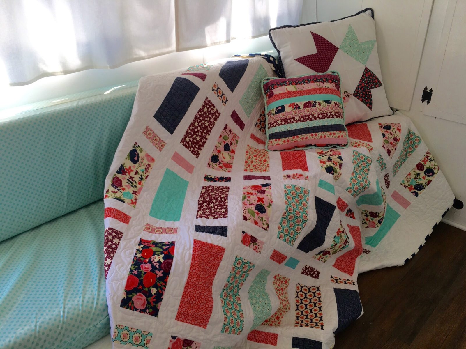 Posy Garden Quilt on Glamper Camper Couch with Pillows Carina Gardner Riley Blake Designs