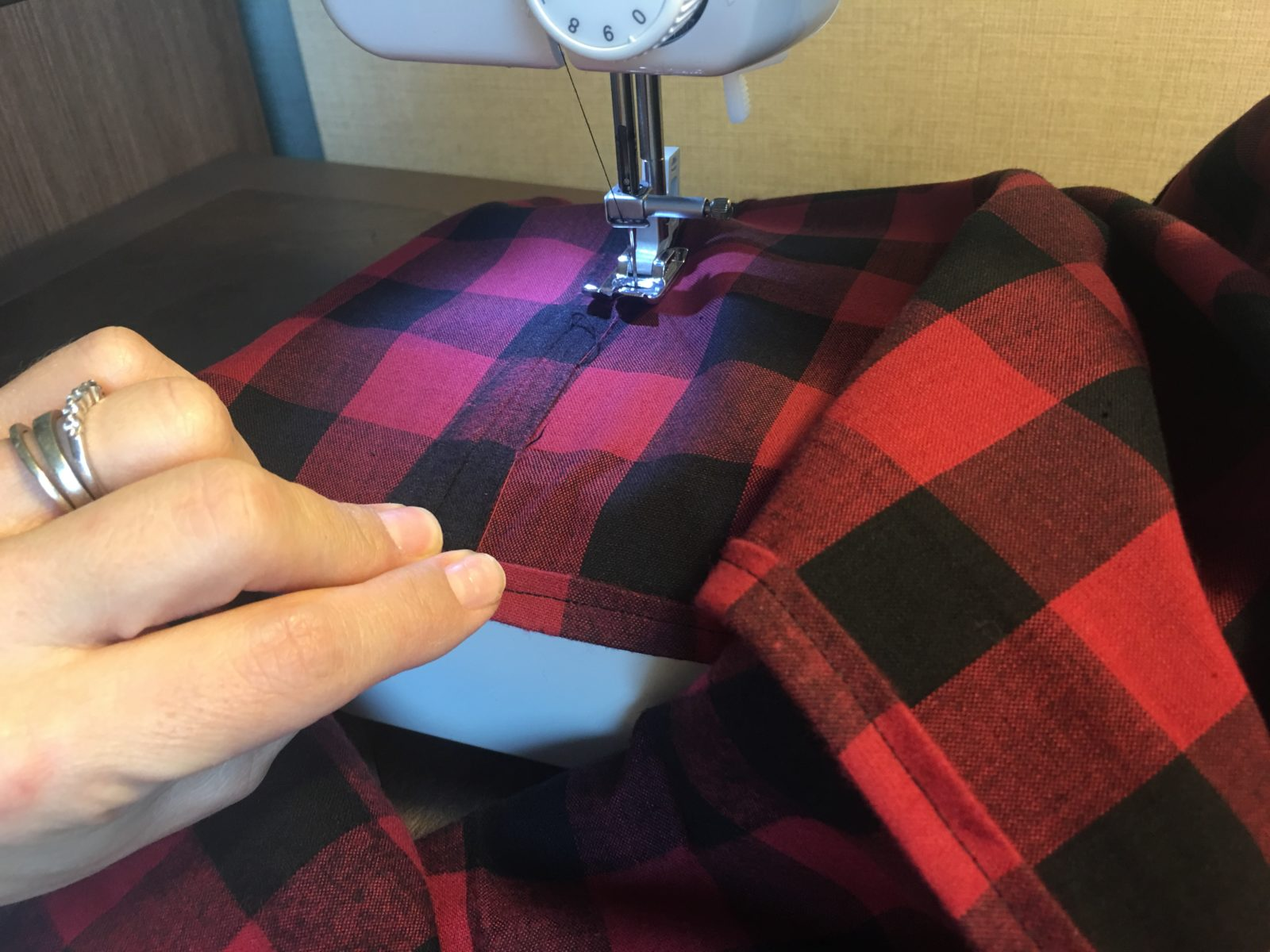 Finish the center seam by rolling the edge and stitching down.
