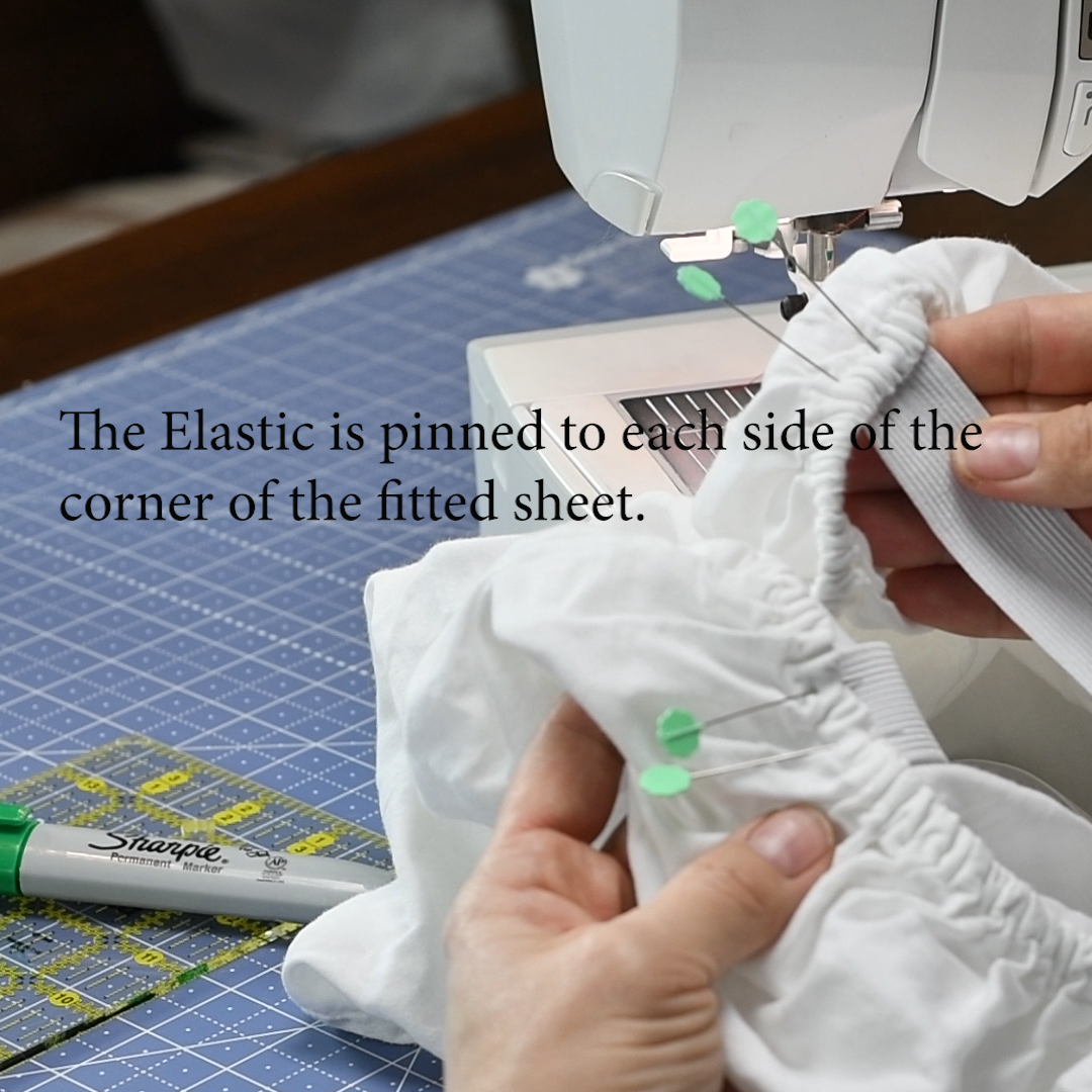 14 Each end of the 18 inch elastic is pin to both corners of the fitted sheet